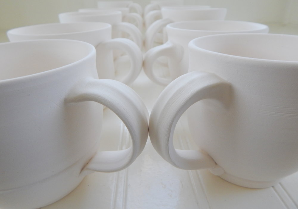 PotteryWhiteMugsUnGlazed.jpg