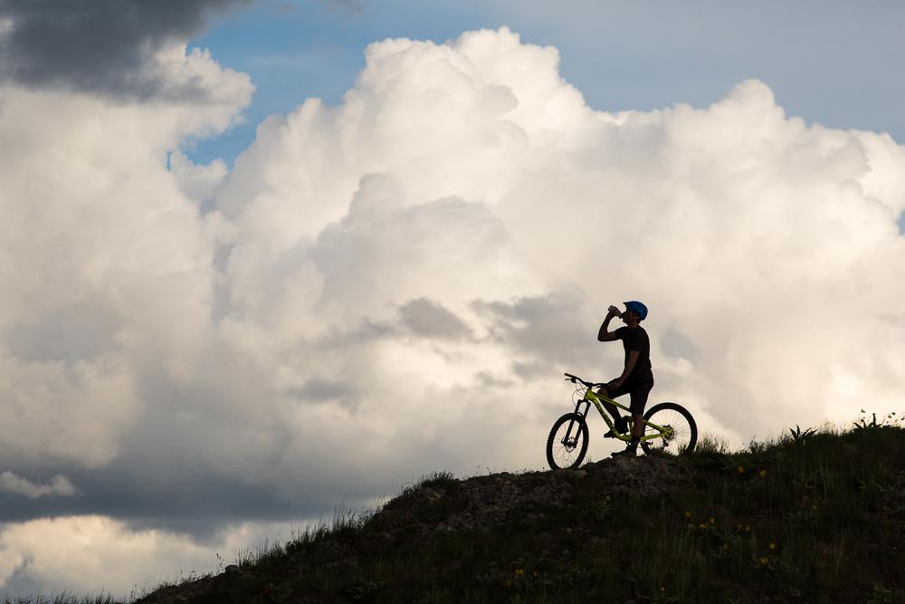 Man drinking water while riding his mountain bike in Utah