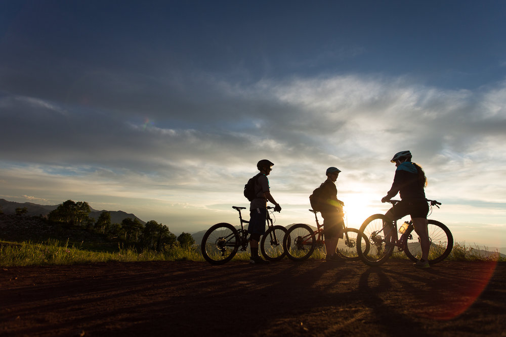 3 riders taking a mid ride break on the Wasatch Crest Trail outside of Salt Lake City, Utah