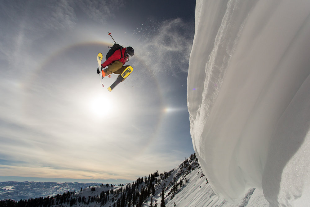 Luke Perin throwing a 360 off a cornice at Brighton Ski Resort