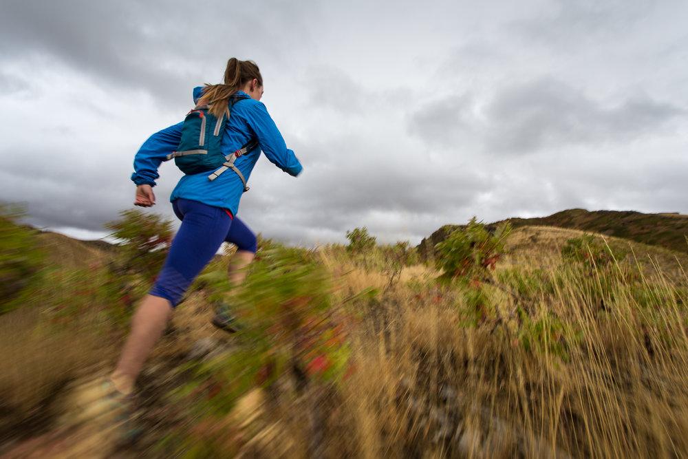 Kaytlin Hughes trail running on the Bonneville Shoreline Trail near Salt Lake City, Utah