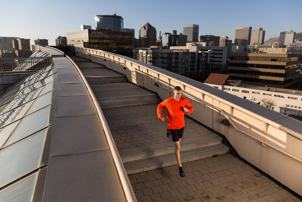 Austin Baker running in downtown Salt Lake City, Utah