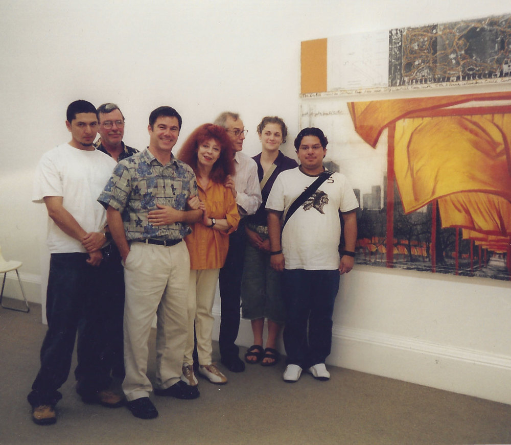 Photo by Ron Abbe  Several HCC students visit Christo's studio in New York with Ron Abbe (taking photo), me, and Jeanne-Claude. In 2005 I worked on installing the Gates Project in the lower east side of Central Park.