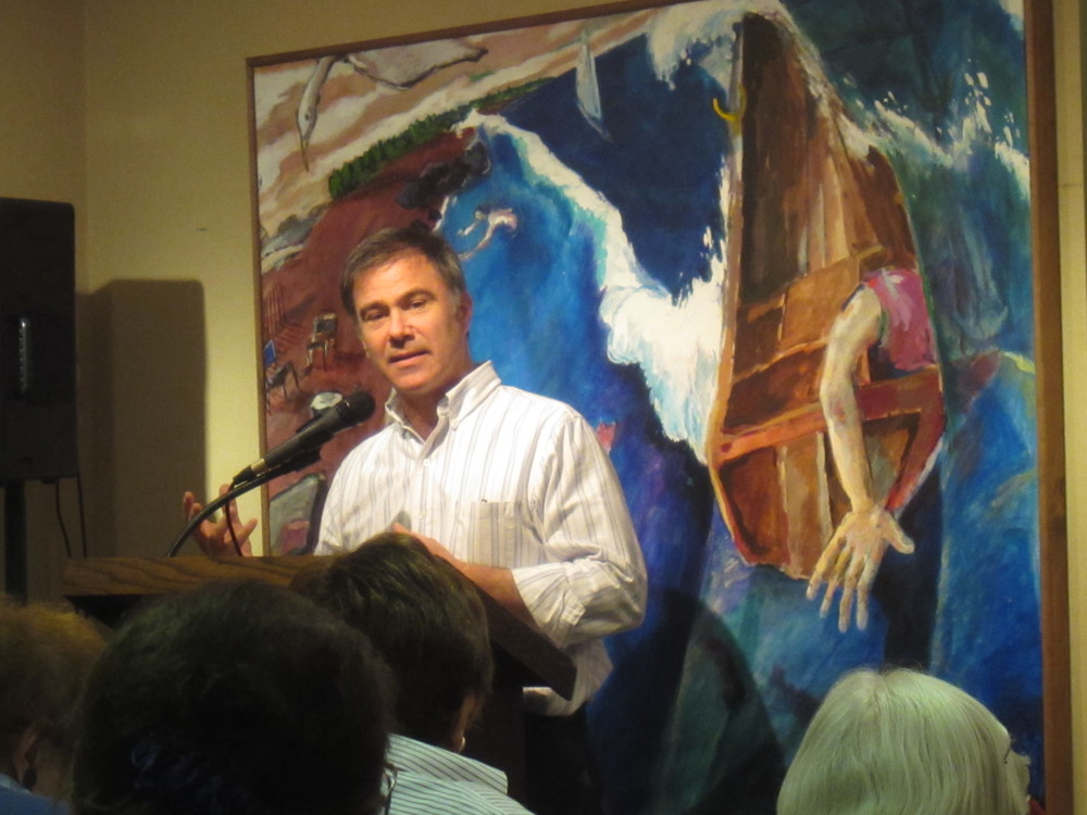 Photo by Ron Abbe  This is a photo of me discussing my work at the Watermark Gallery in Bridgeport, CT. In this solo exhibition I exhibited 22 pieces and gave a brief presentation at the opening reception. The painting behind me is Ebb Tide.