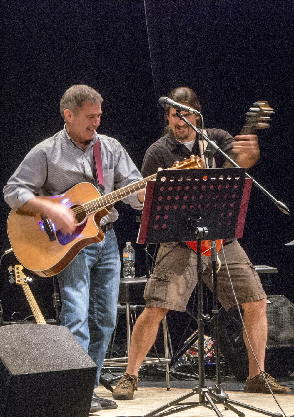 Photo By Tom Brenner  Victor Hogg and I playing at A Musical Concert   Voices Of War   at Housatonic Community College in the fall of 2016. One of the perks of my job is to have the opportunity to perform on stage with some very talented musicians. Click the image to connect to a video clip for a rehearsal for a Warren Zevon Tribute Concert from 2013.