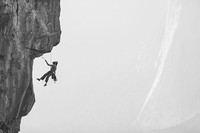 Hanging from the edge of Taft Point (2,500 feet), Bryan Gohn works, The Pointy Part (5.12a), a mentally challenging/cruxy climb that leaves you with a view and sweaty palms for everyone watching. Yosemite National Park, CA. Happy new year 💥