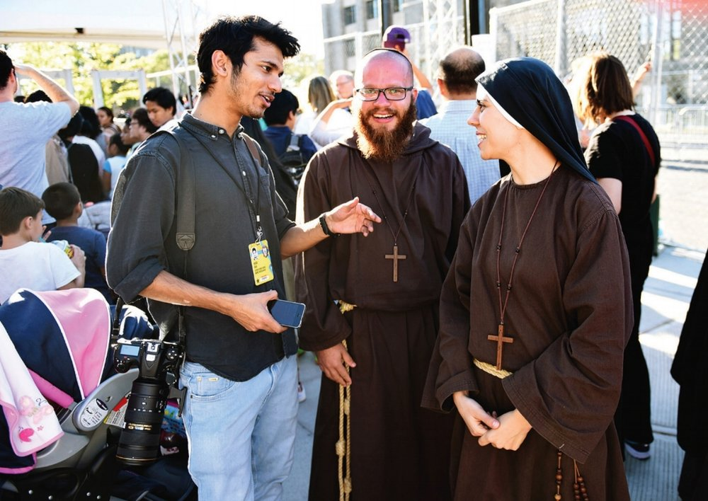 Interviewing evangelists from Brazil during the Pope's visit to Washington DC. Photo by John Beale