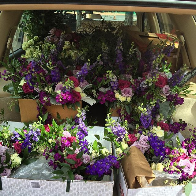 Car full of flowers for a beautiful late #summerwedding at the #gardenofthegodsclub - what a fun day! #coloradowedding #gotg #purpleroses #coloradosprings