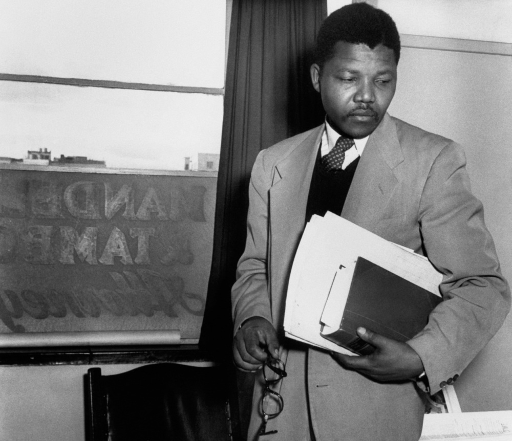 A 34 year old Nelson Mandela opened his office with Oliver Tambo on Fox Street in 1952. It was the first black law practice in Johannesburg.  (Jurgen Schadeberg/Bailey's African History Archives)