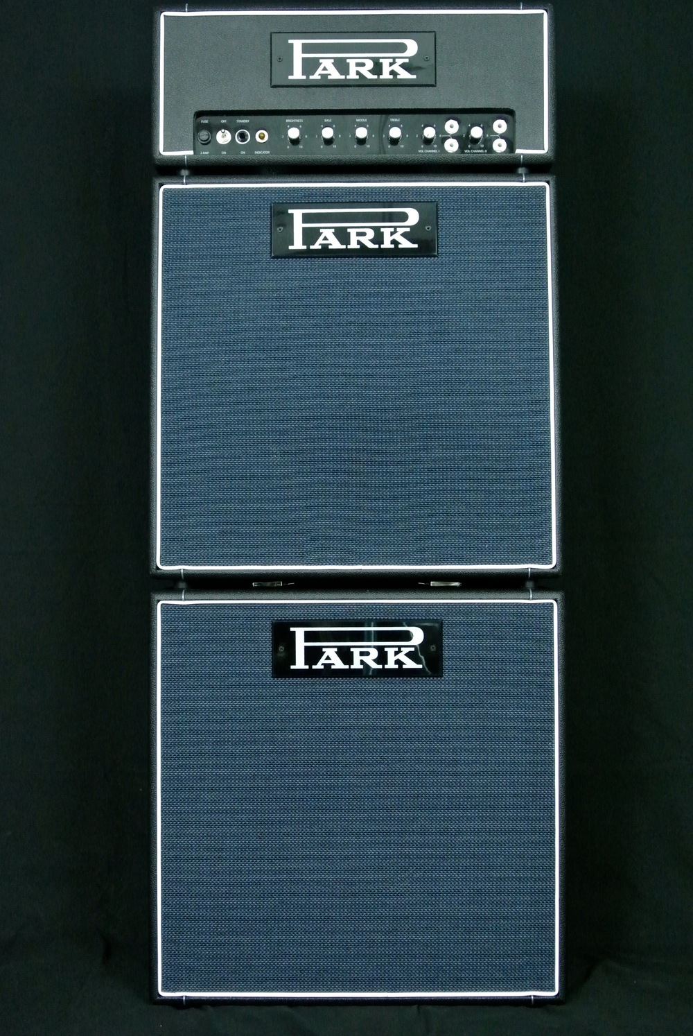"Park Little Stack. Park Little Head 18 with PLCT (Park Little Cab Top) and PLCB (Park Little Cab Bottom). Each houses one Celestion G12-65 Creamback M 12"", 16 ohm speaker). Little cabs are 21"" x 21"". The top cab is slightly angled back. The bottom depth is 11"". The top depth is 9.5""."