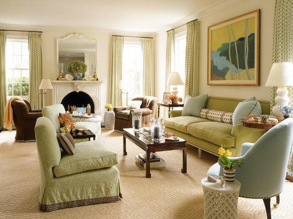 This space takes its color cues from the abstract landscape above the sofa, but keeps the main elements of the space in a very narrow range of spring greens and icy sky blues.  Touches of brown provide a grounding influence, and prevent the pastel tones from feeling overly saccharine.  Design by Ashley Whittaker.
