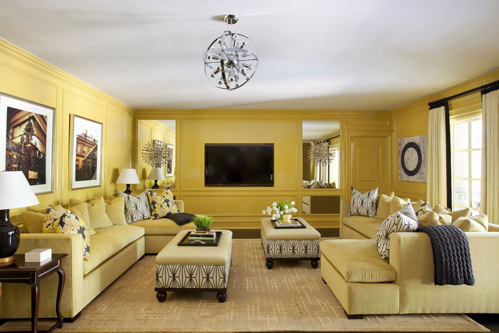 Designer Tobi Fairley's take on monochromatic color also features a single tone of lemon yellow, continued in slightly less vivid increments from the walls to the sofas and area rug.  Again, accents in black and charcoal grey offset the allover color.