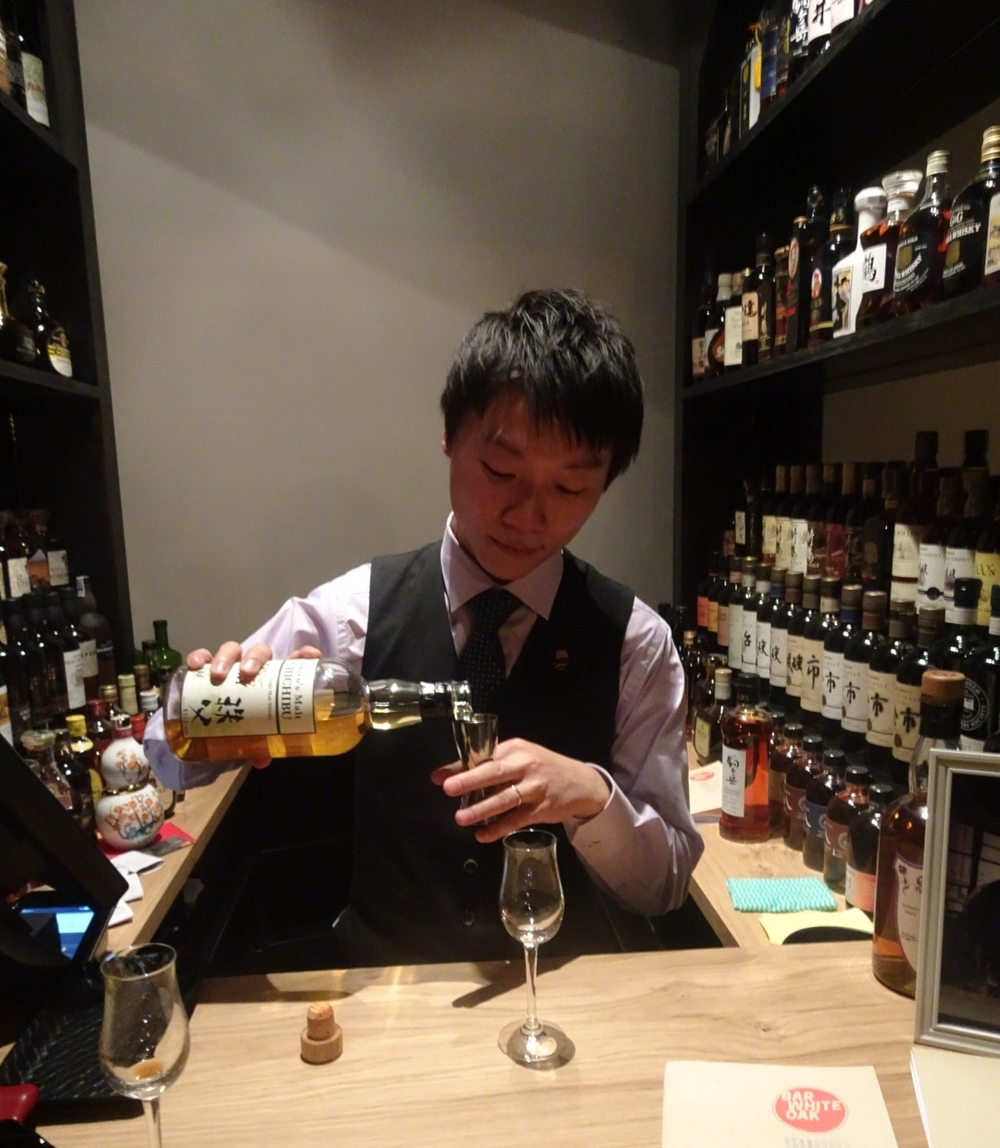 "Pop up curator Kelvin Low pouring a dram - you will find him in this spot most nights guiding punters through the whiskies ""on exhibit."""