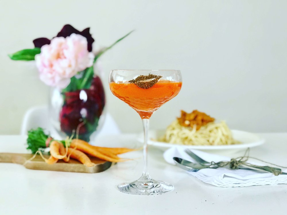 Zero waste cocktail made with carrot and ginger juice, apple brandy and kombucha