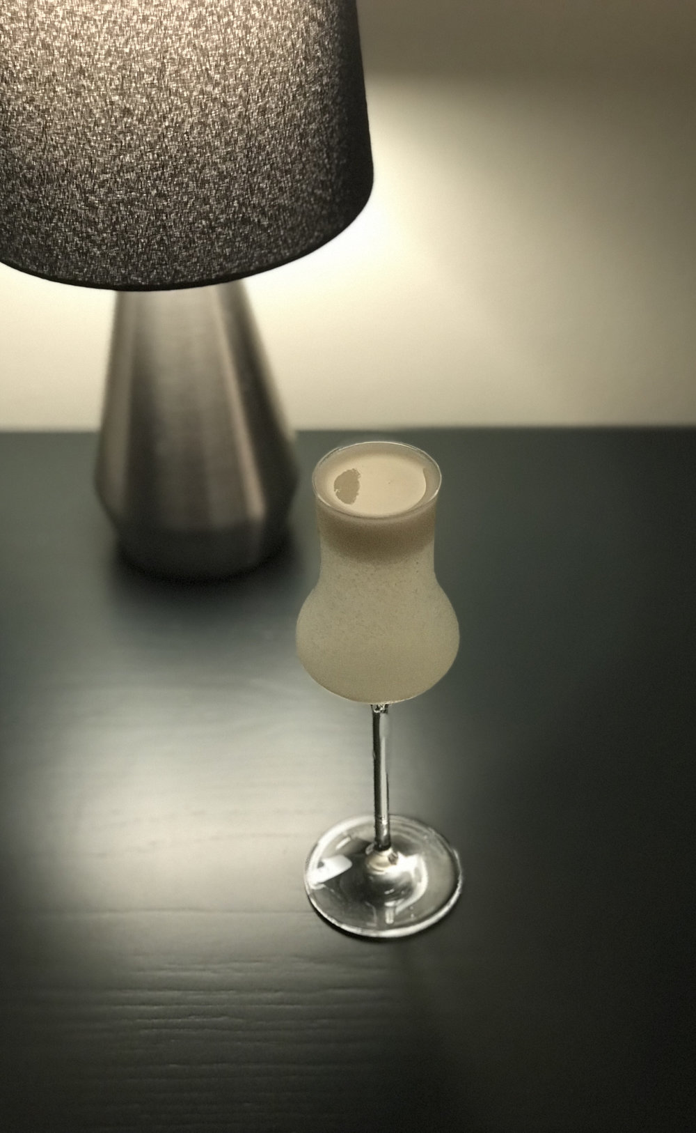 One of the recipes from One Bottle Cocktail, the Silken Sour, which uses tofu to help give the cocktail its texture and also that foam