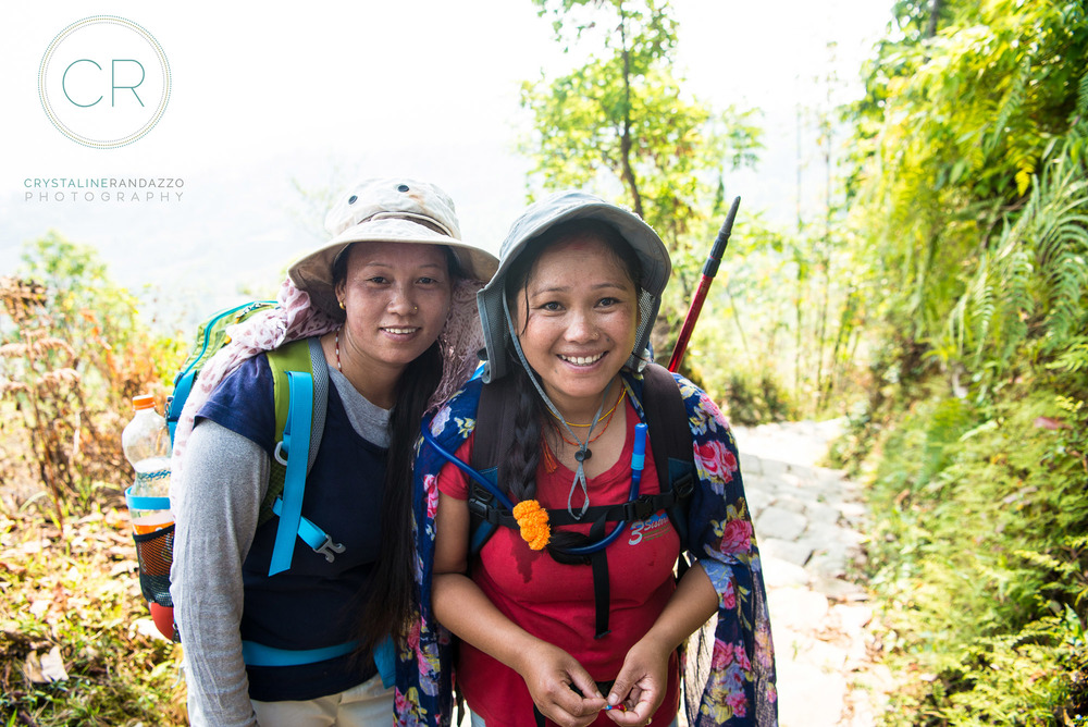 Three Sister's guide Muna (in red) and my assistant guide Tukashi leading our team of three women on the Annapurna trail.