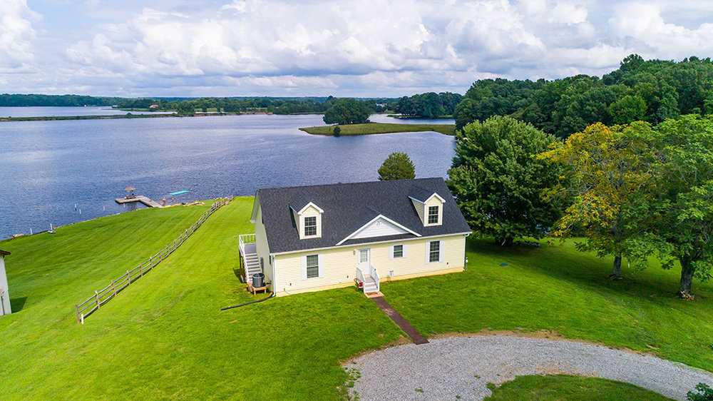 From ground level, you could barely tell there was a lake behind this property. However by flying a drone about 30 ft into the air, breathtaking views are exposed, showcasing the proximity to the lake that vacationers desire.