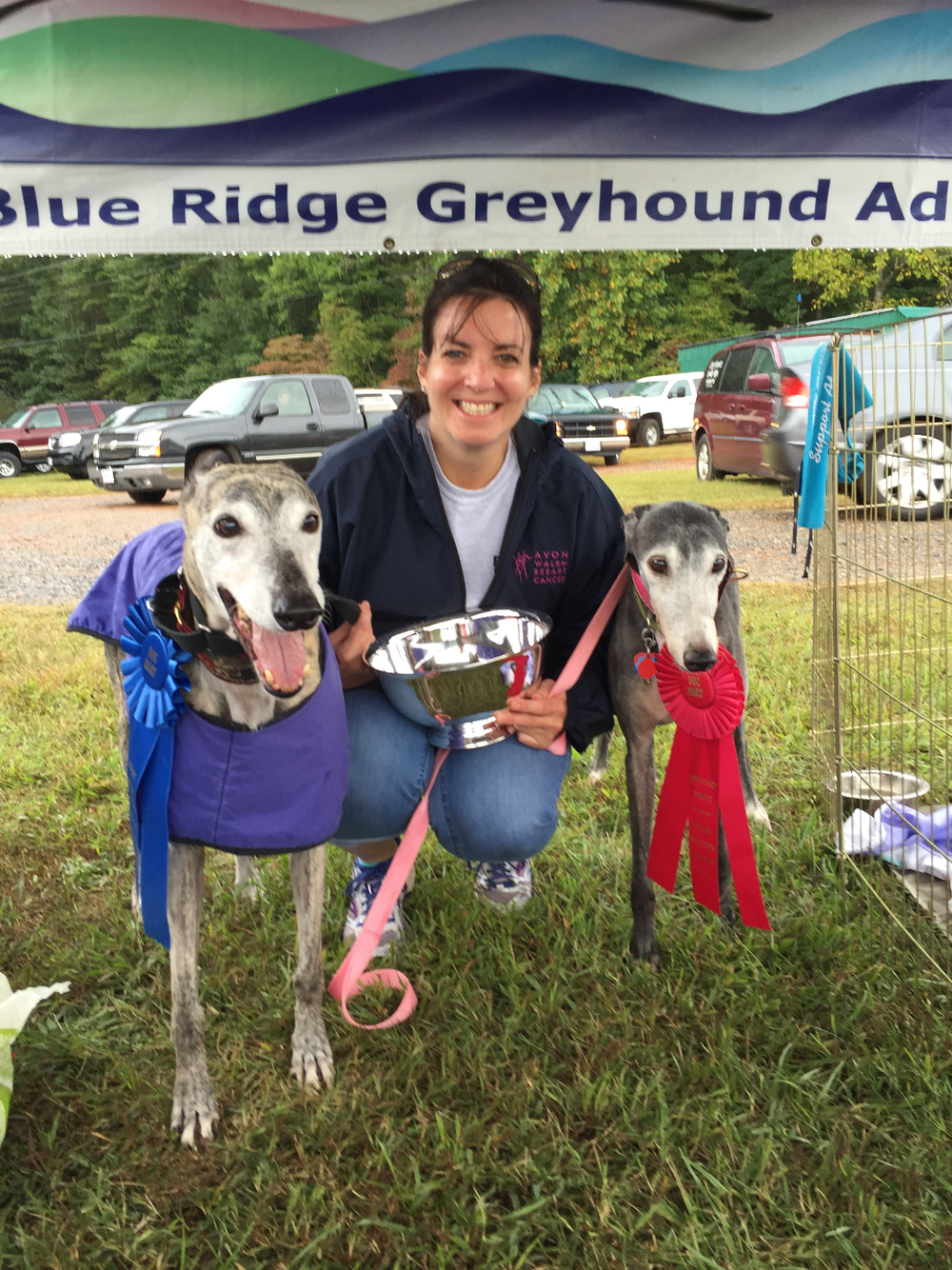 Gracie with her blue ribbon and silver Best in Show bowl, and Lollipop with her red ribbon.