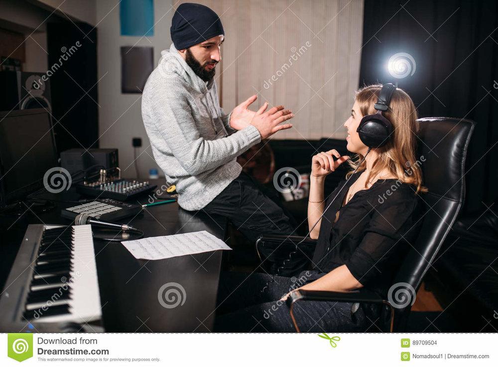 sound-producer-female-singer-music-studio-work-headphones-song-record-professional-digital-technologies-89709504.jpg
