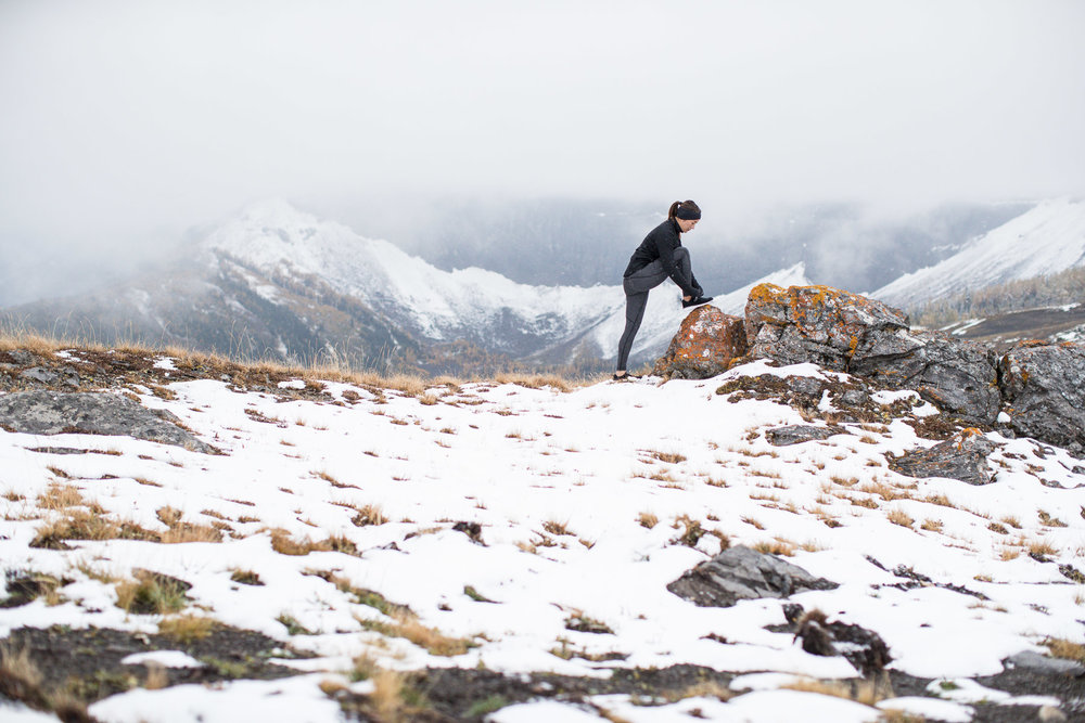 Ashley Barker LuluLemon Banff Mountain Tops Snow Fog Composition Rocks Stretching