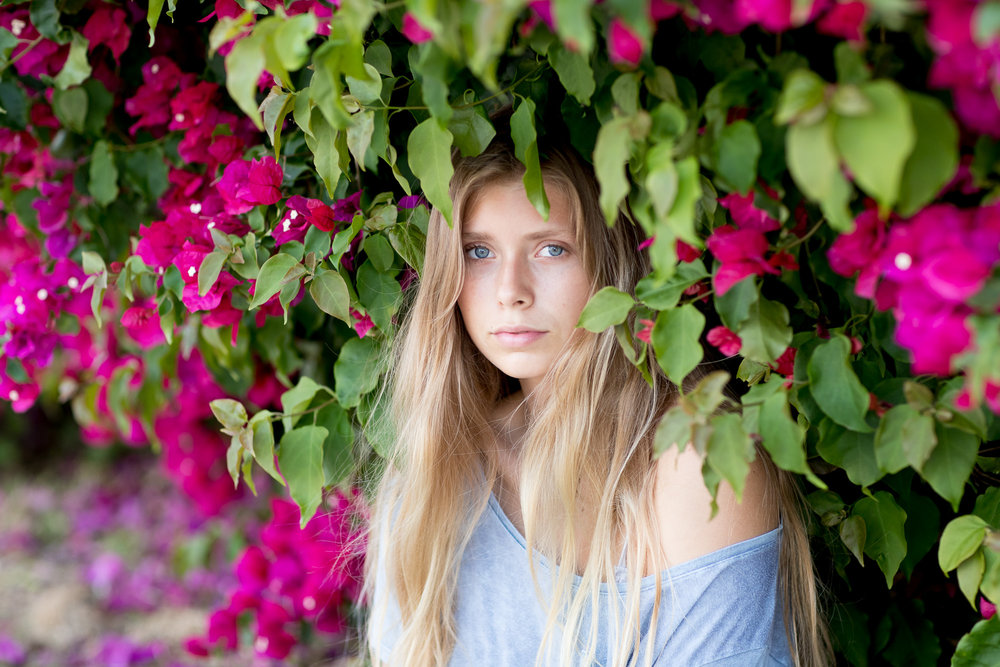 pink flower bush portrait teen photographer commercial talent long hair los angeles female blue eyes