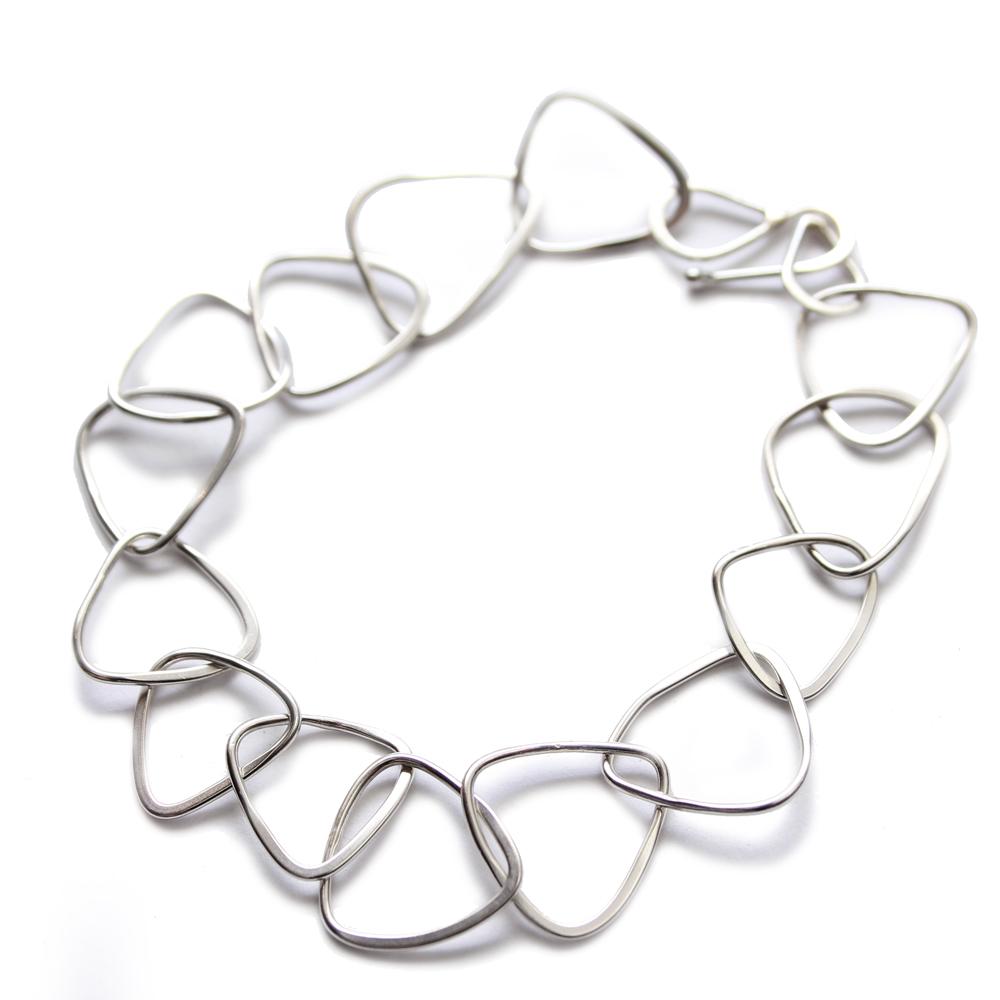 Merus tri silver bracelet cropped.jpg