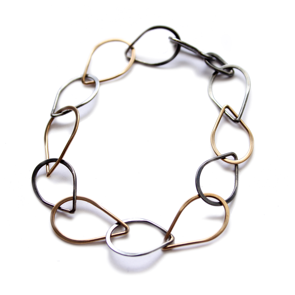 Merus black gold bracelet cropped.jpg