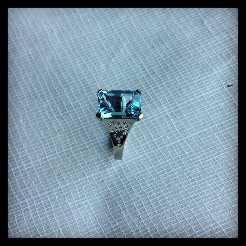 White Gold Ring Set With An Emerald Cut Aquamarine