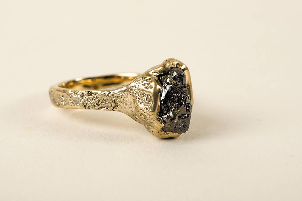 5 carat raw diamond and 18 carat gold engagement ring