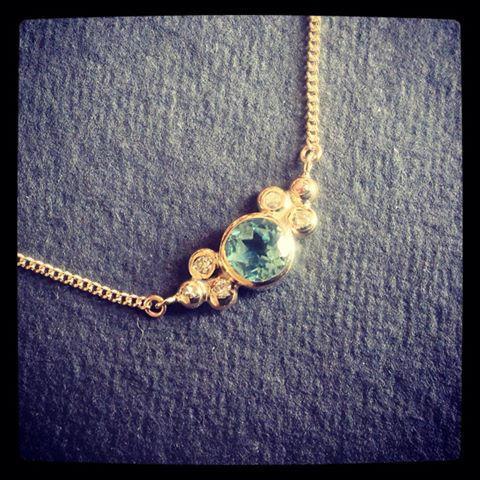 A gold pendant made from a customers old jewellery