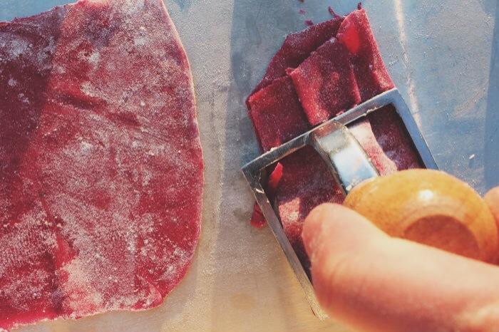 stamping the ravioli dough