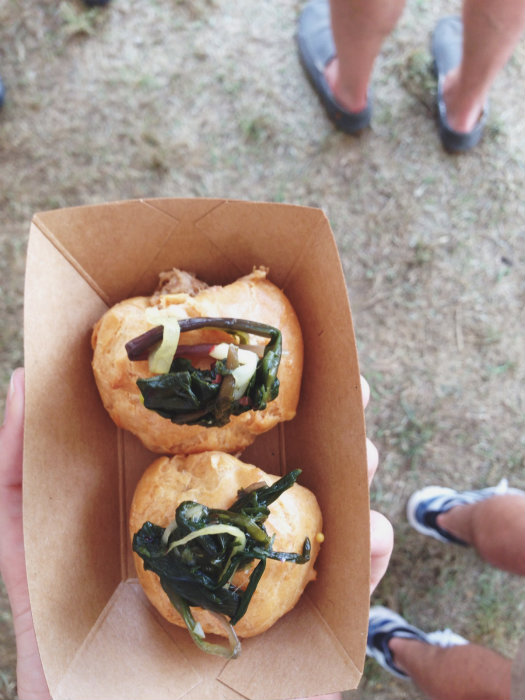 Pulled pork inside pastry dough topped with wilted greens.