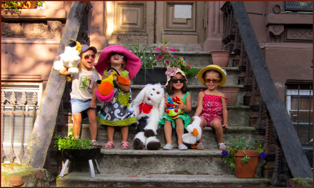 [Helen (left), the youngest of our clan, leads her friends in puppeteering on our stoop in Brooklyn]