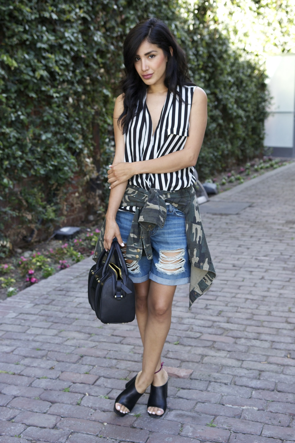 Zara top and mules, Forever21 Jacket, DL1961 shorts, H&M bag                                                                        Photos by Jovhany Morales