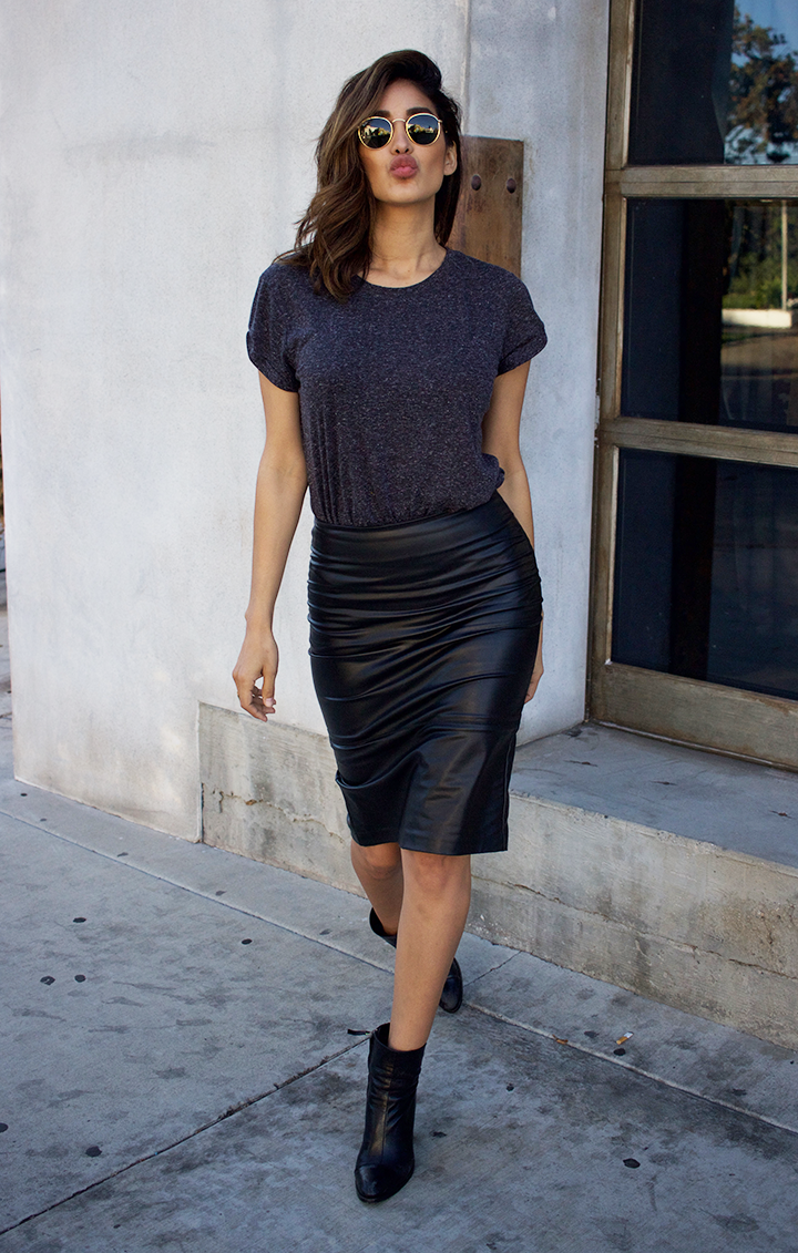 Have you ever been tempted to buy a leather pencil skirt but weren't sure if you could pull it off? I think most girls can agree that leather skirts always look good on a hanger but are not so easy to style without looking a little like Kelly Bundy. I personally think a basic tee and sneakers are great pieces to style any skirt without looking over the top. Here's how I styled my favorite leather skirt and still looked casual and cool.