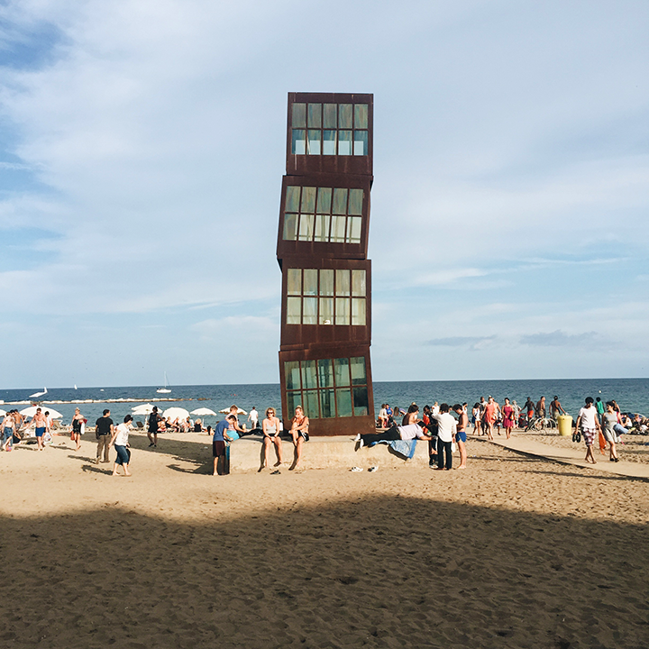 """Homenatge a la Barceloneta"" was designed by Rebecca Horn. It is a famous art piece on the beach of Barceloneta. The leaning tower is an iconic point of reference and apparently where many groups of friends meet to socialize."