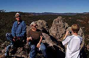 Three generation family enjoying views from rock formations