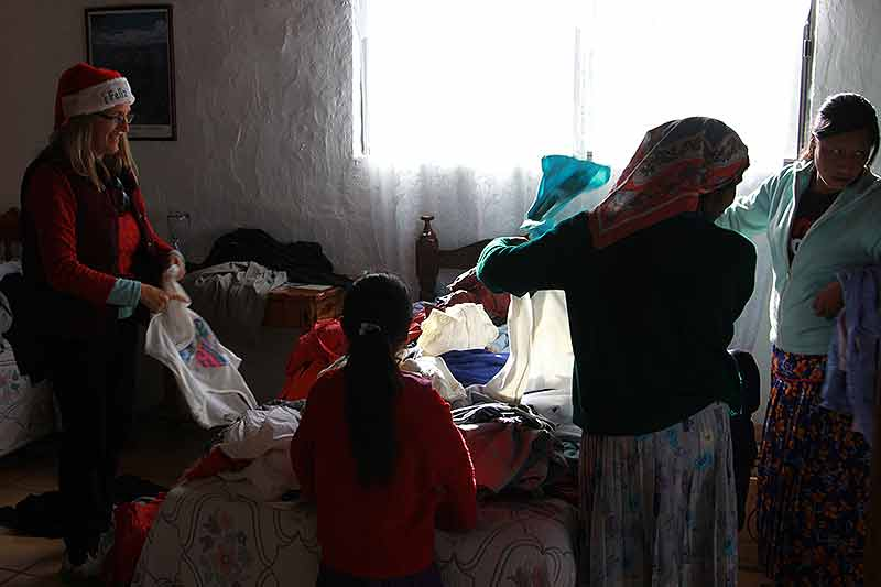Raramuri women picking out from donated clothes for their families for Christmas in the Copper Canyon, Mexico