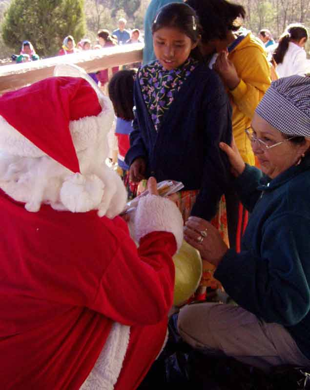 Santa giving out toys to the Raramuri in the Copper Canyon, Mexico