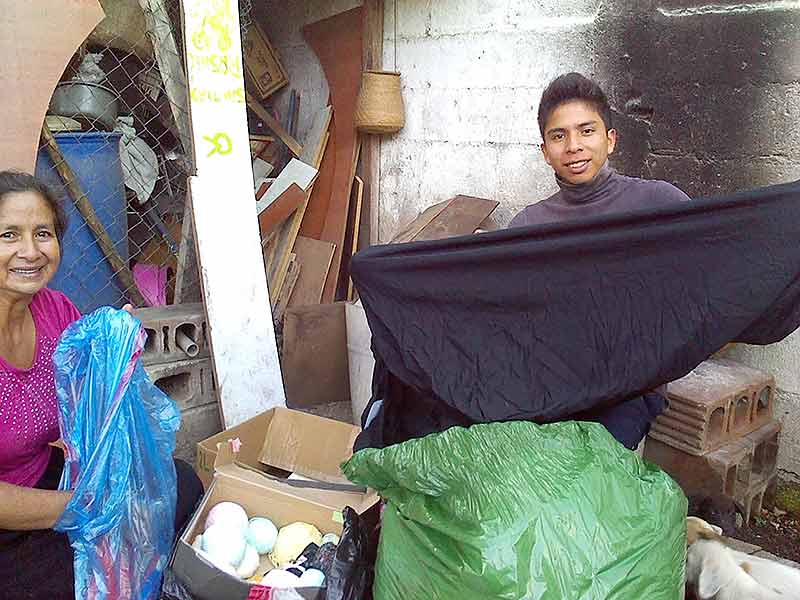 Christian and his mother, Linda, pleased to be going through the donations of TRANSITIONS Foundation of Guatemala, 2013