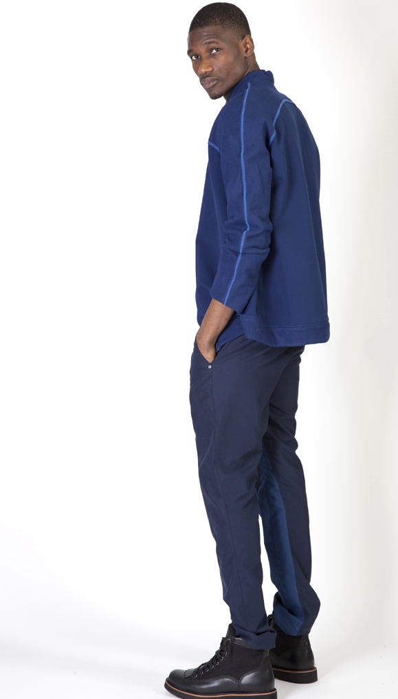 The shirt and pants are made in sanded micro suede. It's very water repellent and breathable.