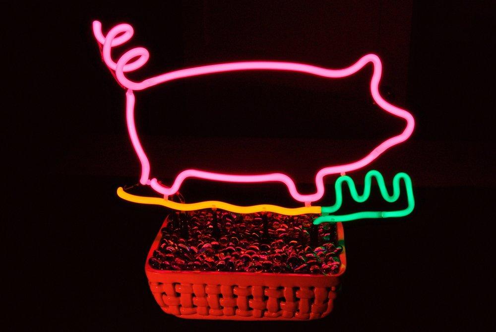 Dazzling neon pig tabletop sculpture