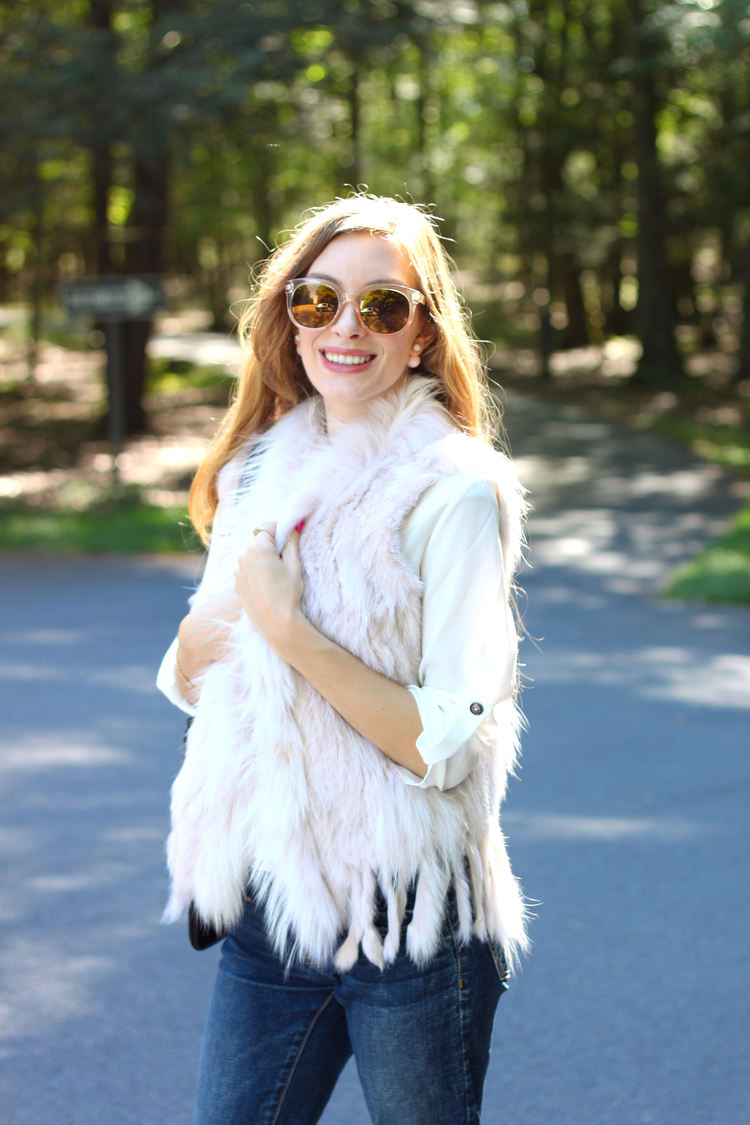 Picture of blogger, Enchanting Elegance, wearing the WILSONS LEATHER NATURAL BLUSH SHADE RABBIT FUR VEST.