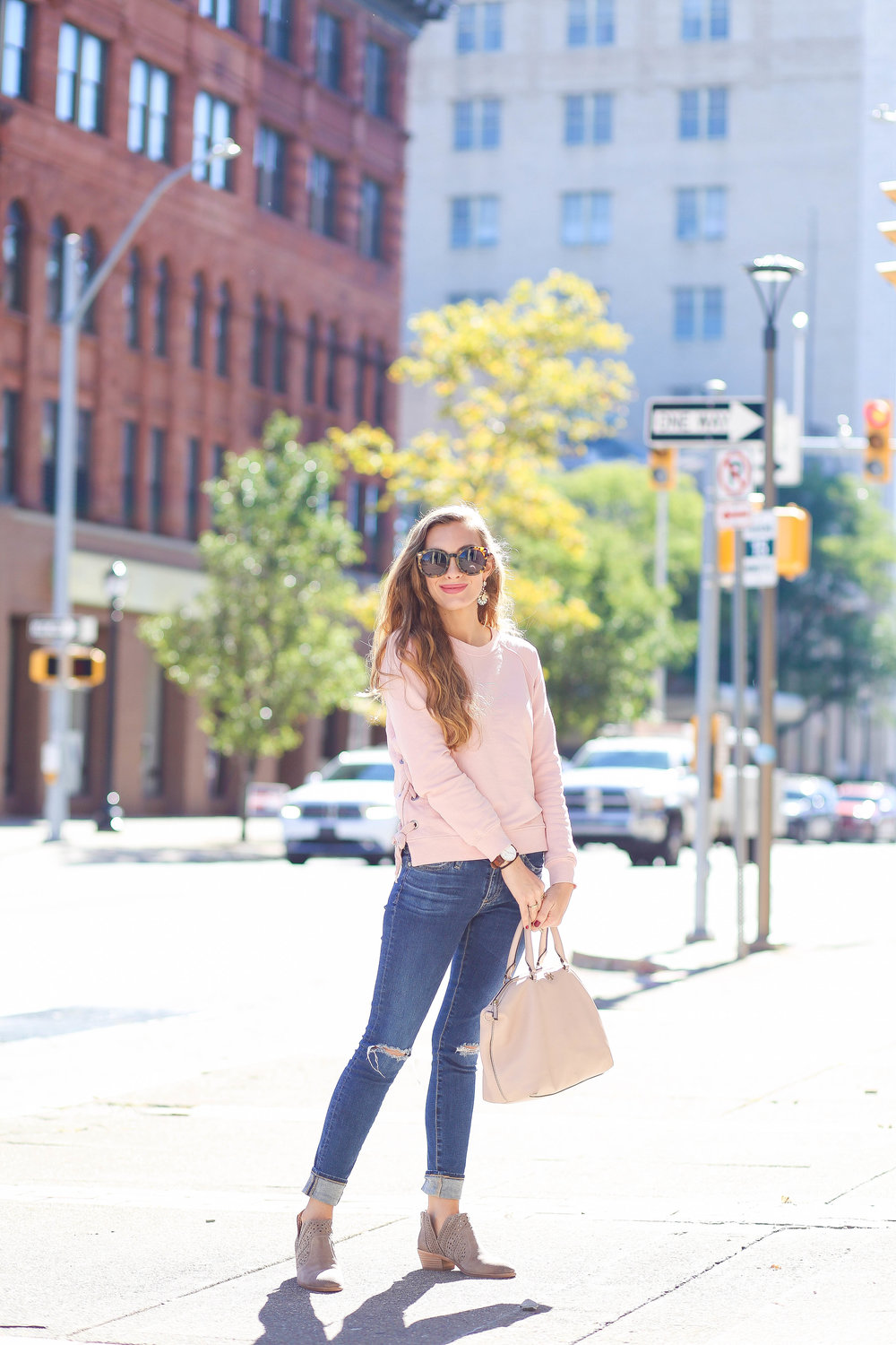 Pink Sweatshirt. Skinny Jeans. Blush Bag. Gray Booties.