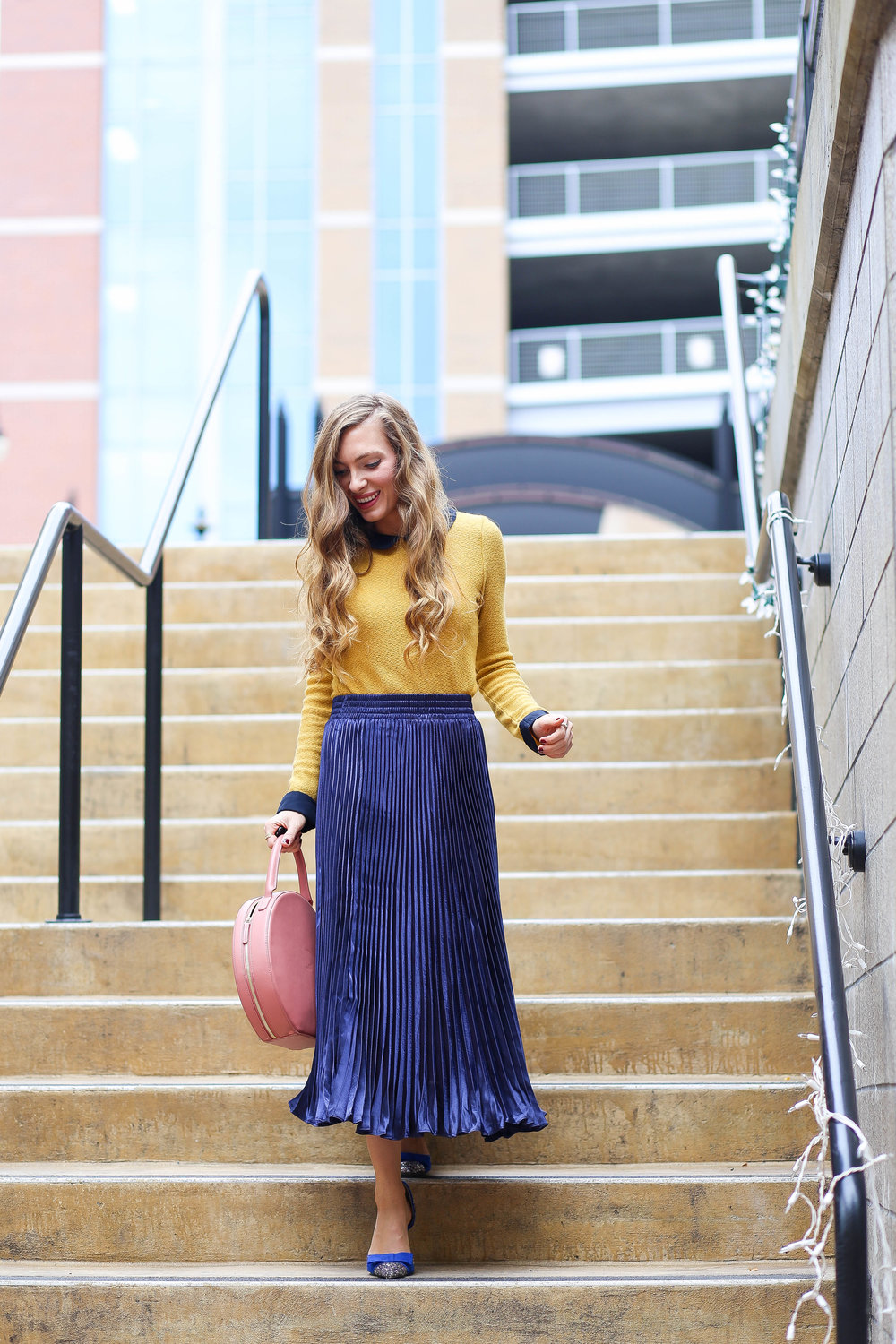 Mustard Top. Peter Pan Collar. Blue Pleated Skirt. Blush Circle Bag. Blue Heels.