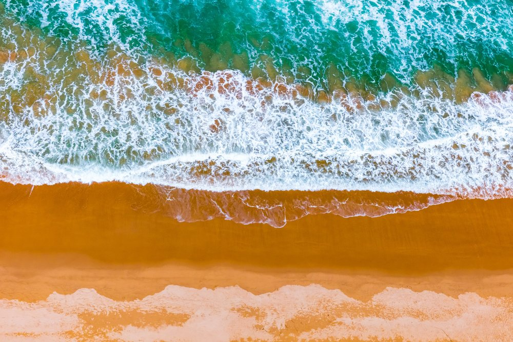 Where Golden Sands Kiss Emerald Seas