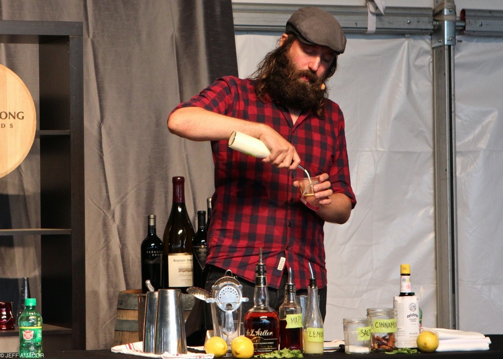 Jason Stevens, bar program manager for Congress and Second Bar + Kitchen, crafting a unique cocktail using bourbon, maple syrup, lemon juice, cream, salt, cinnamon, and bitters.