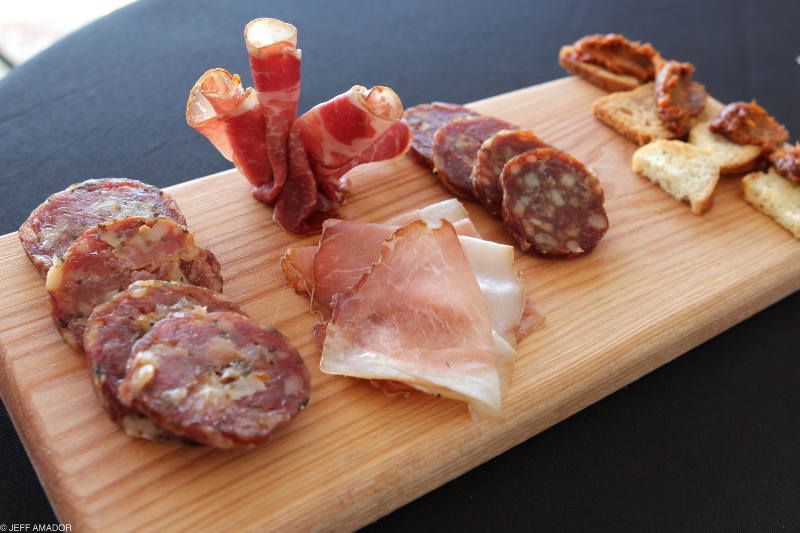 Salumi board featuring two types of salami, coffee lomo, coppa, and n'duja.