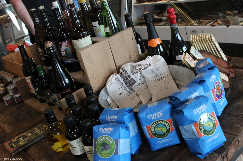 A selection of local products also available for purchase, including Cuvee Coffee, Jester King Brewery beer, and Confituras preserves.