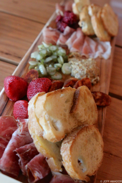 Salumiboard featuring pickled strawberries, raspberries, and celery, house mustard, coppa, Mexican-style chorizo, coffee lomo, and jambon fume (smoked ham).